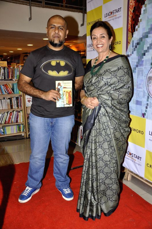 Bollywood music director Vishal Dadlani with author Pratima Kapur during the launch of book Tapestry in Mumbai on May 15, 2014.