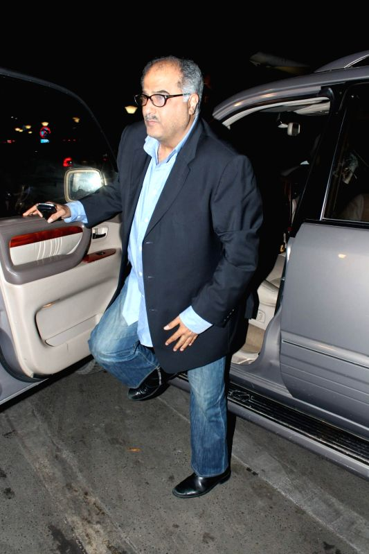 Bollywood producer Bonney Kapoor leave for 13th IIFA awards to Singapore at International Airport. - Kapoor
