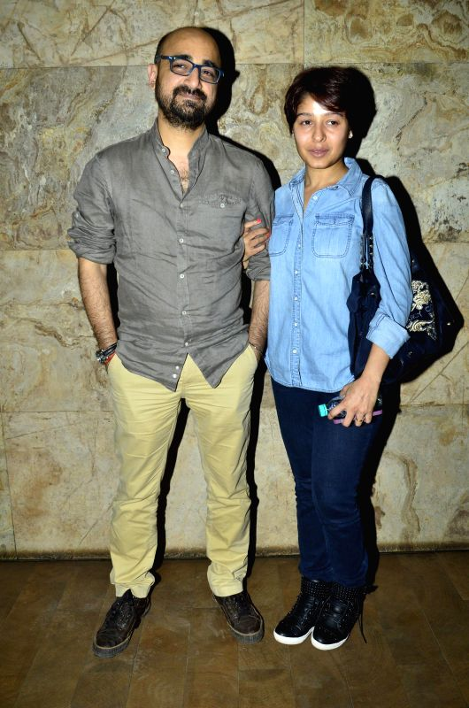 Bollywood singer Sunidhi Chauhan along with her husband Hitesh Sonik during the special screening of film Hawaa Hawaai in Mumbai, on April 29, 2014. - Sunidhi Chauhan