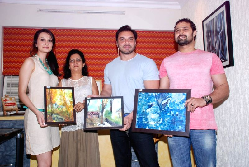 Bollywood stars Sohail Khan and Vaishali Desai were spotted at Nandita Desai`s art work auction, ...