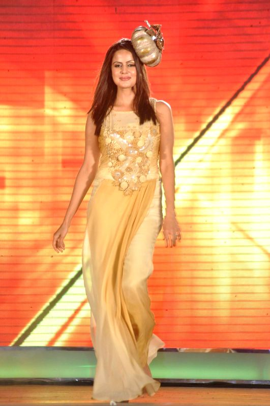 Bollywood stars walk on the ramp for `Girl Child` Fashion Show.