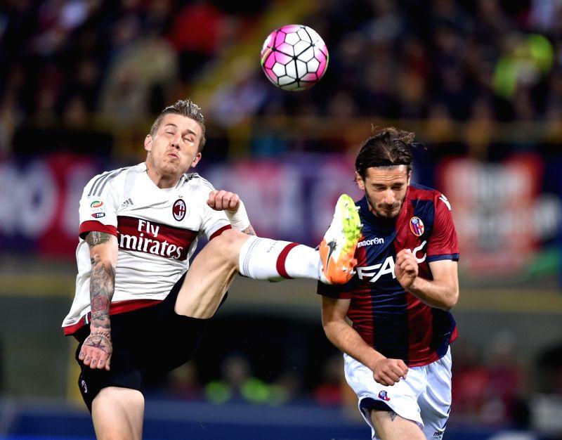 BOLOGNA, May 8, 2016 - Juraj Kucka (L)of AC Milan competes during the 2015-2016 season Serie A football match against Bologna in Bologna, Italy, May 8, 2016. AC Milan won 1-0.