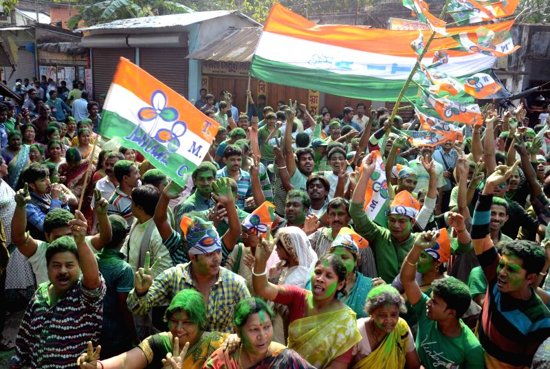Trinamool Congress (TMC) supporters celebrates after their win over Bongaon by-poll at North 24 Parganas in West Bengal, on Feb 16, 2015.