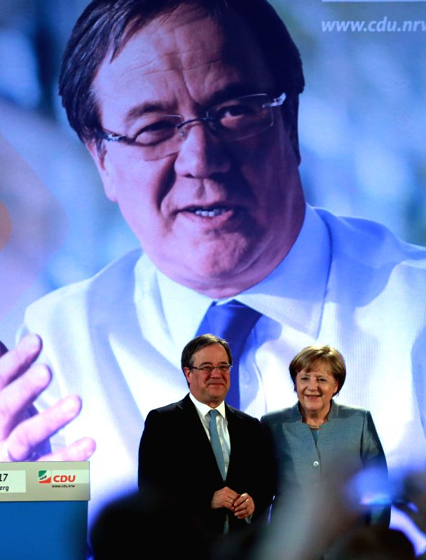 BONN, May 5, 2017 - German Chancellor Angela Merkel (R) and Armin Laschet, Christian Democratic Union (CDU) leader in North Rhine-Westphalia, attend a CDU campaign rally for state elections in North ...