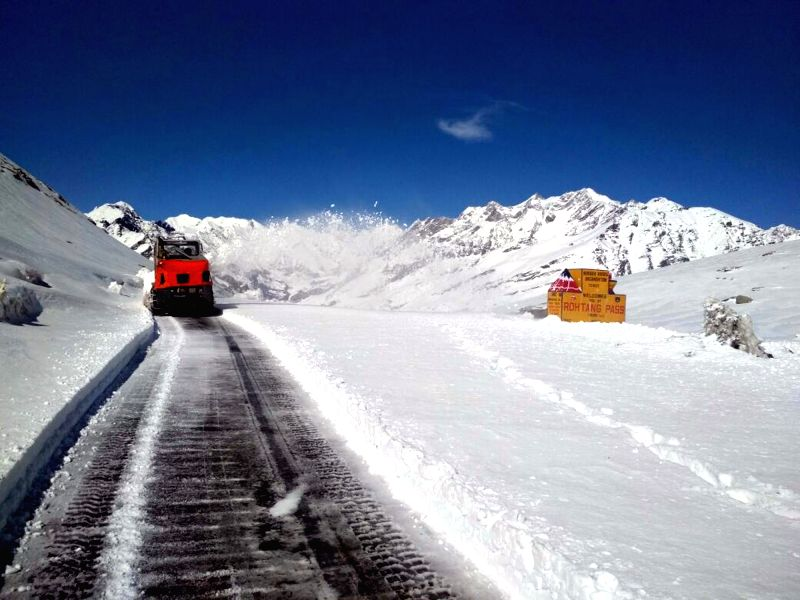 Border Roads Organisation (BRO) machinery clearing snow on Manali-Sarchu road at Rohtang top in Himachal Pradesh on April 13, 2018.