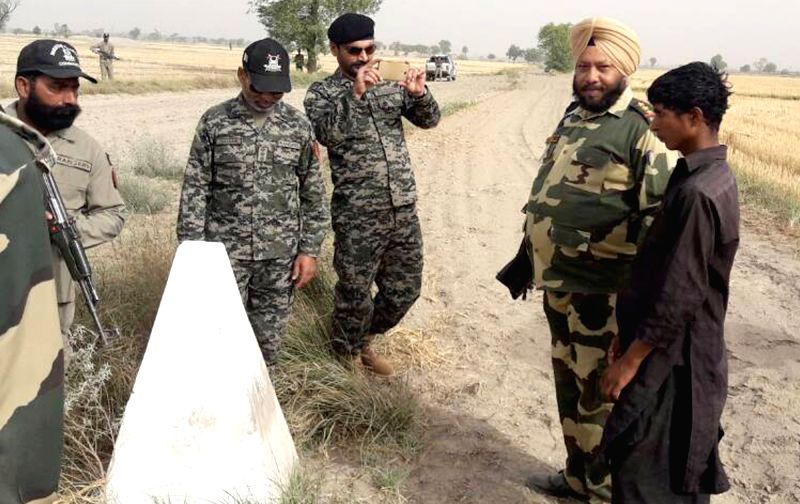 Border Security Force (BSF) personals handing over a 15 years old Pakistani national Razak Mai to Pakistani Rangers from Border Out Post Sowar Wali in Abohar sector near Fazilka on April 29, ...