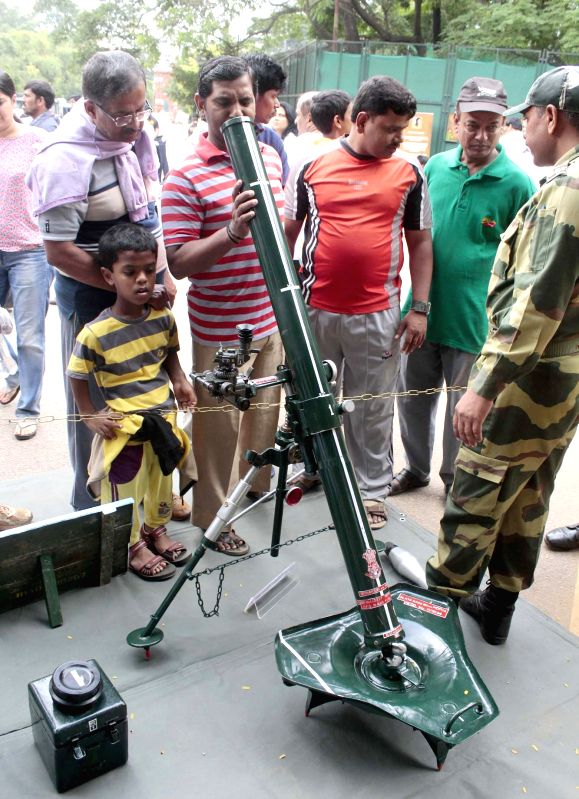 Border Security Force personnel display their weapons during an interaction with civilians `Know Your Army` at Cubbon Park, in Bengaluru on July 5, 2015.