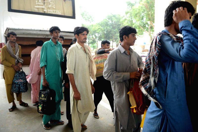 Border Security Force release 14 Pakistani fishermen held for violating its territorial waters at Attari-Wagah border,  Punjab, on Aug 7, 2018.