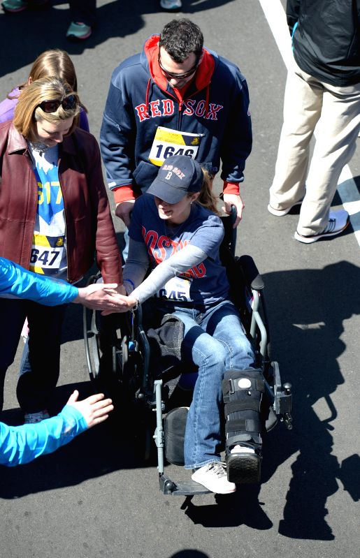 2013 Boston Marathon bombing survivor Rebekah Gregory DiMartino (in wheelchair) attends a Tribute Run in Boston, Massachusetts, the United States, April 19, 2014. ..