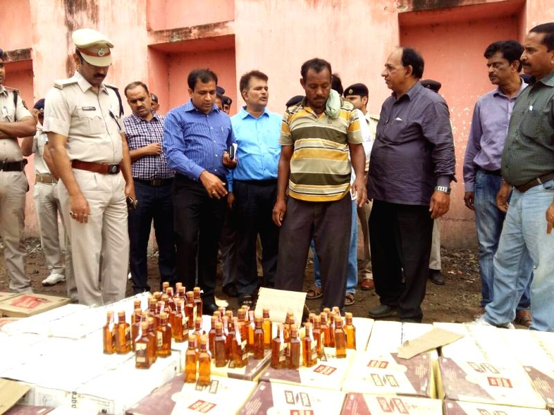 Bottles of confiscated illegal alcohol being destroyed in Patna on May 9, 2017.
