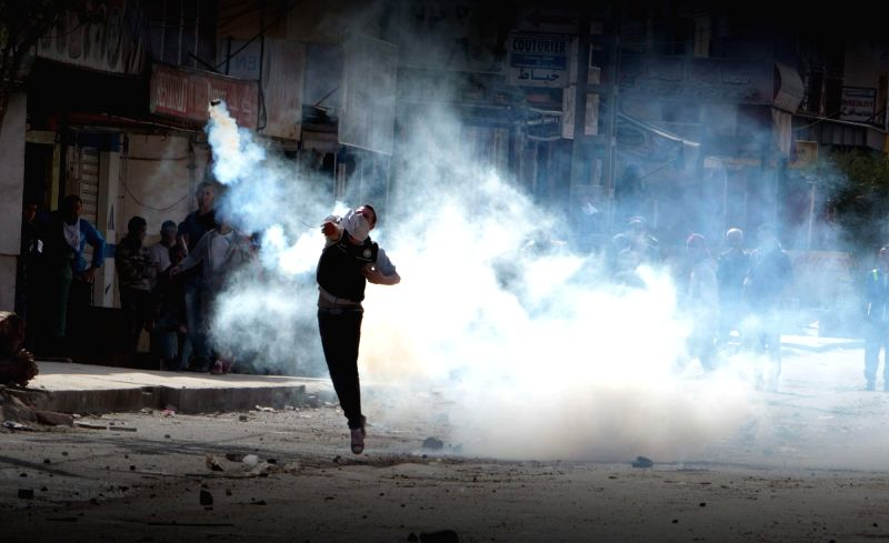 BOUIRA (ALGERIA), April 17, 2014 Protesters and anti-riot troops clash in Machdallah, Bouira Province, Algeria, on April 17, 2014. Several injuries were reported during Thursday's clash. .