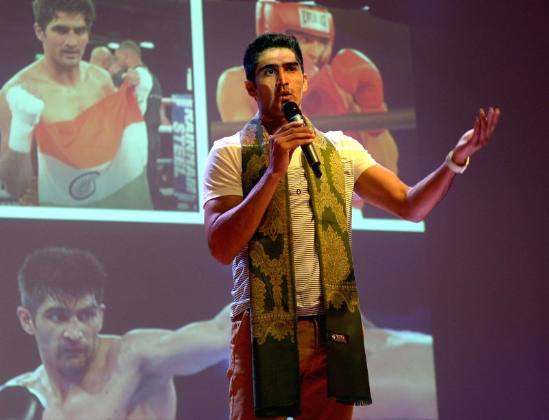 Boxer Vijender Singh addresses students during a motivational session at a school, in Kolkata on July 17, 2018. - Vijender Singh