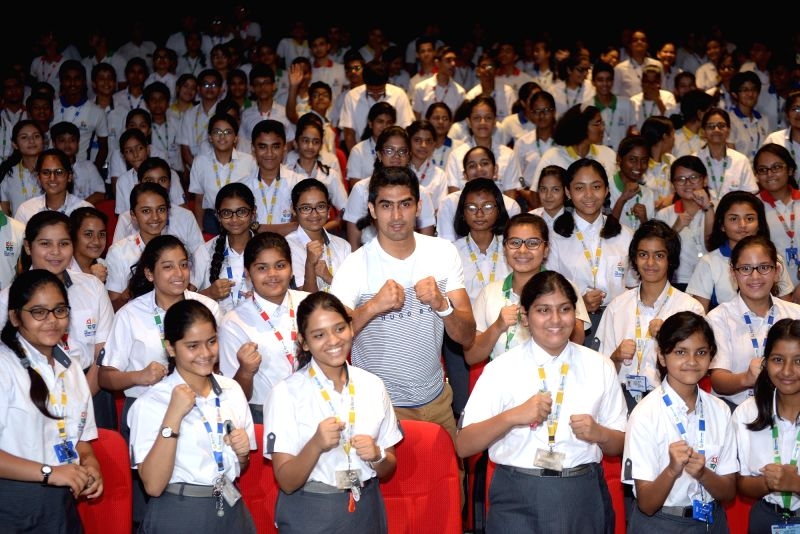 Boxer Vijender Singh with the students during a motivational session at a school, in Kolkata on July 17, 2018. - Vijender Singh