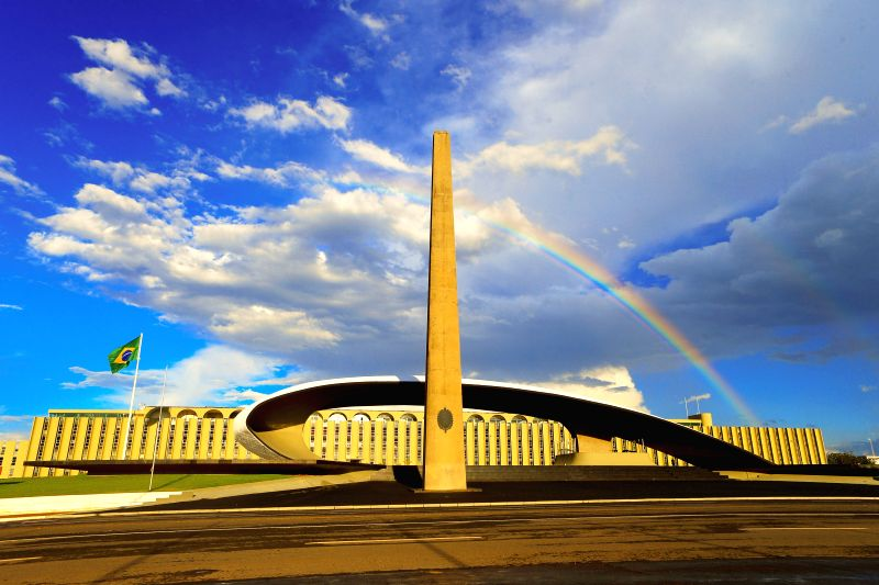 Photo taken on April 25, 2014 shows the cloud and rainbow in Brasilia, capital of Brazil. Seated on the Goias plateau, the city enjoys a ever-changing scenery of .