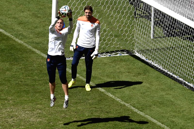 Netherlands' goalkeepers Jasper Cillessen(L) and Tim Krul attend a training session at the Estadio Nacional Stadium in Brasilia, Brazil, on July 5, 2014. ...