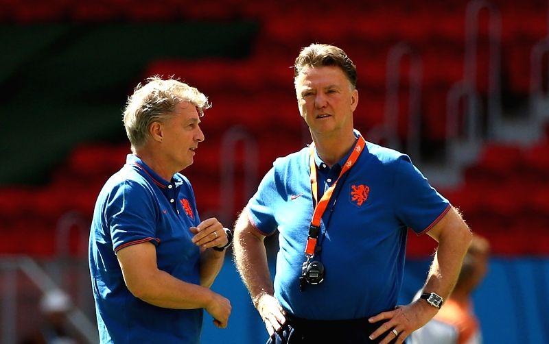 Netherlands head coach Louis van Gaal(R) looks on during a training session at the Estadio Nacional Stadium in Brasilia, Brazil, on July 5, 2014. Netherlands will .