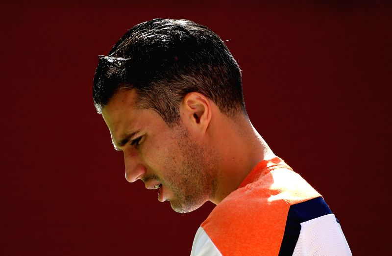 Robin van Persie of Netherlands attends a training session at the Estadio Nacional Stadium in Brasilia, Brazil, on July 5, 2014. Netherlands will play the 2014 ...