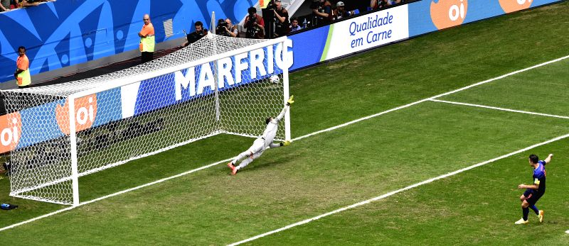 Brazil's goalkeeper Julio Cesar (L) fails to save a penalty kick shot by Netherlands' Robin van Persie during the third place play-off match between Brazil and ...