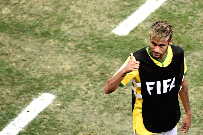 Brazil's Neymar gestures to fans during the third place play-off match between Brazil and Netherlands of 2014 FIFA World Cup at the Estadio Nacional Stadium in ...