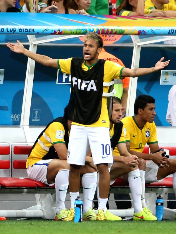 Brazil's Neymar reacts during the third place play-off match between Brazil and Netherlands of 2014 FIFA World Cup at the Estadio Nacional Stadium in Brasilia, ...
