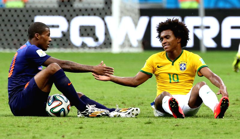 Netherlands' Georginio Wijnaldum and Brazil's Willian shake hands during the third place play-off match between Brazil and Netherlands of 2014 FIFA World Cup at ...