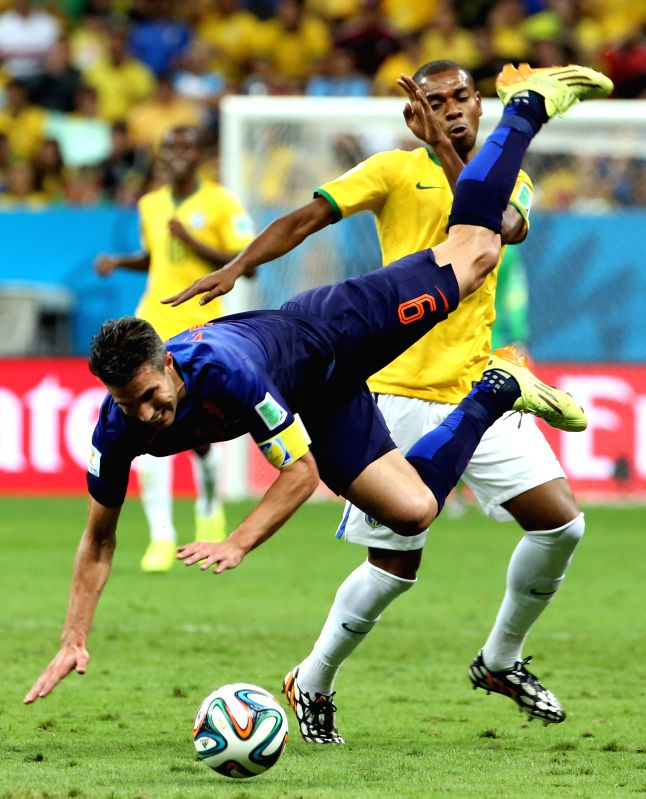 Netherlands' Robin van Persie (front) falls down during the third place play-off match between Brazil and Netherlands of 2014 FIFA World Cup at the Estadio ...