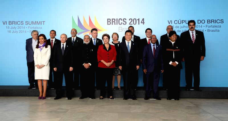 Chinese President Xi Jinping (3rd R, front) poses for a group photo with participants of a dialogue between BRICS countries' leaders and presidents from 11 South ..