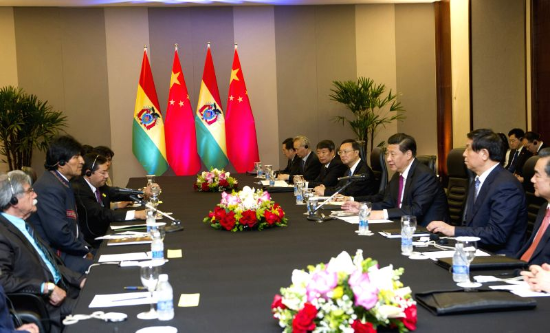 Chinese President Xi Jinping meets with Bolivian President Evo Morales in Brasilia, Brazil, July 16, 2014.