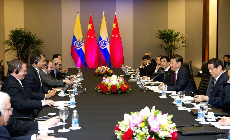 Chinese President Xi Jinping meets with Ecuadorian President Rafael Correa in Brasilia, Brazil, July 16, 2014.