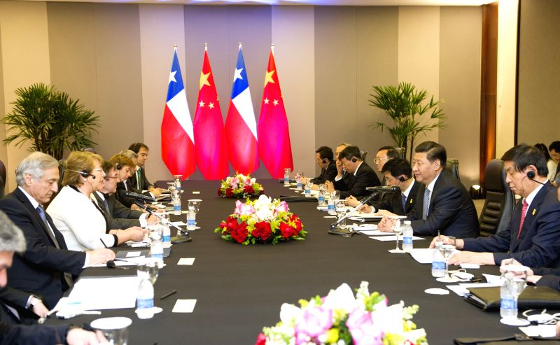 Chinese President Xi Jinping meets with Chilean President Michelle Bachelet in Brasilia, Brazil, July 16, 2014.