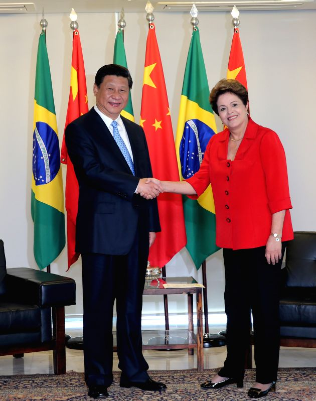 Chinese President Xi Jinping (L) and his Brazilian counterpart Dilma Rousseff shake hands during their meeting in Brasilia, Brazil, July 17, 2014. (Xinhua/Lan ...