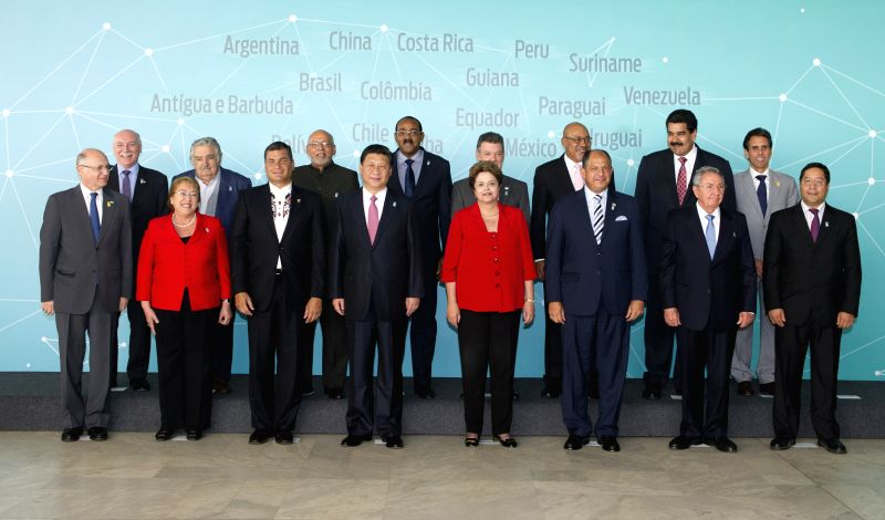 Chinese President Xi Jinping (4th L, front) poses for a group photo before attending a summit with 11 Latin American and Caribbean leaders in Brasilia, Brazil, ...