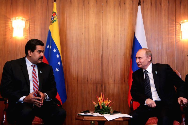 Venezuelan President Nicolas Maduro (L) meets with his Russian counterpart Vladimir Putin (R), in Brasilia, Brazil, on July 16, 2014. (Xinhua/Presidential ...