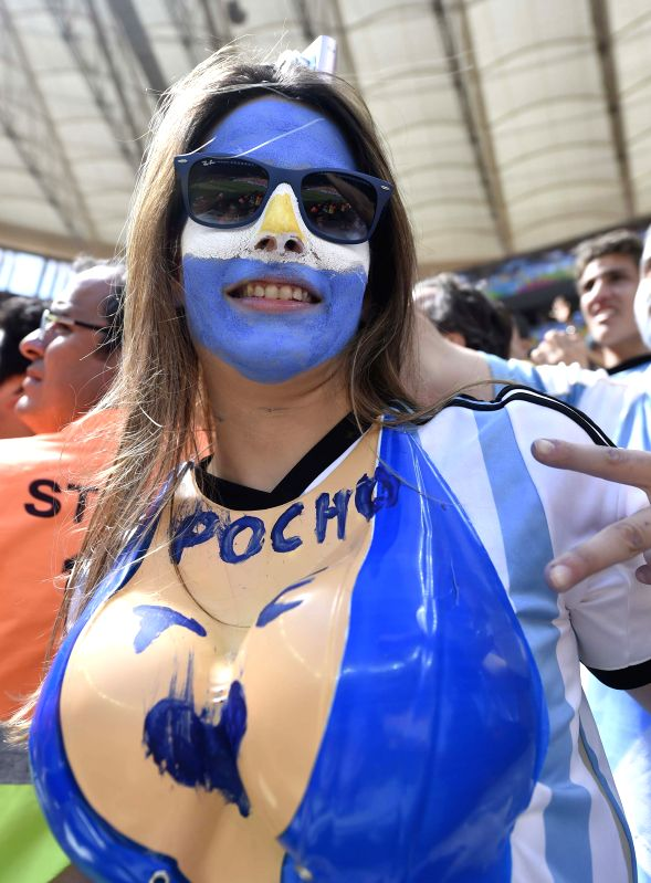 An Argentina's fan poses before a quarter-finals match between Argentina and Belgium of 2014 FIFA World Cup at the Estadio Nacional Stadium in Brasilia, Brazil, on .