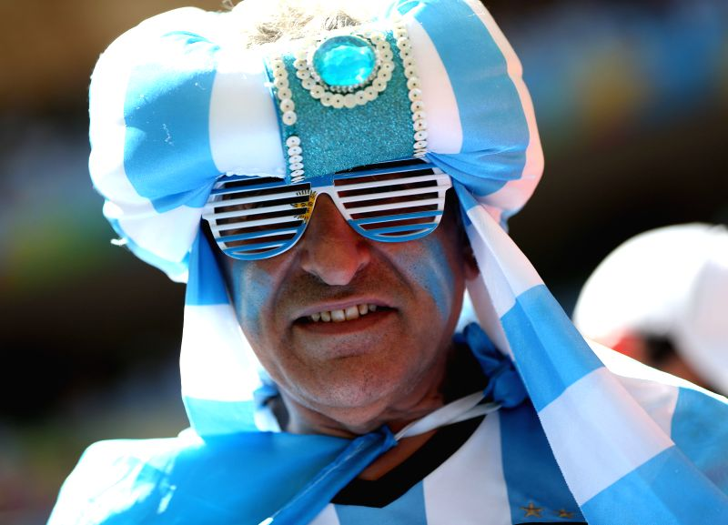 An Argentina's fan waits for a quarter-finals match between Argentina and Belgium of 2014 FIFA World Cup at the Estadio Nacional Stadium in Brasilia, Brazil, on ...