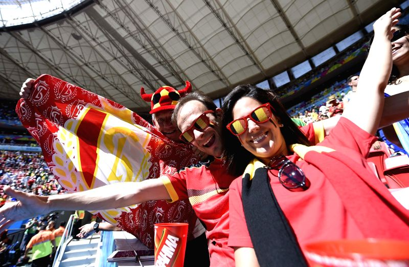 Belgium's fans pose before a quarter-finals match between Argentina and Belgium of 2014 FIFA World Cup at the Estadio Nacional Stadium in Brasilia, Brazil, on July .