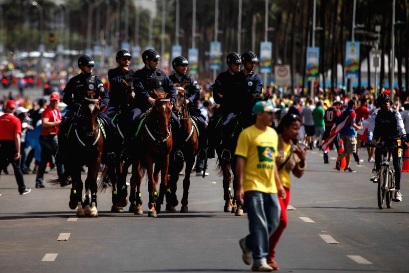 Mounted police officers guard outside the Estadio Nacional Stadium in Brasilia, Brazil, on June 15, 2014.