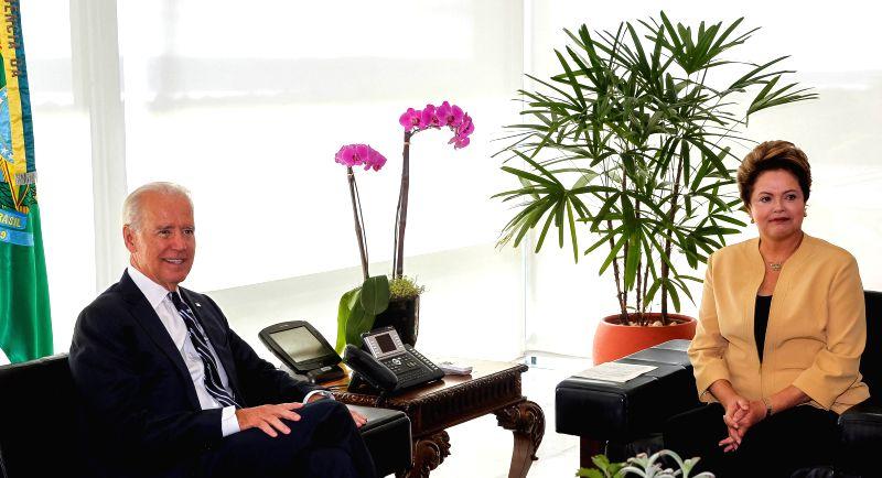 Brazil's President Dilma Rousseff (R) meets with U.S. Vice President Joe Biden in Brasilia, Brazil, on June 17, 2014.