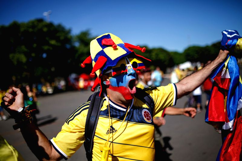 A Colombia's fan cheers near the Estadio Nacional Stadium before a Group C match between Colombia and Cote d'Ivoire of 2014 FIFA World Cup, in Brasilia, Brazil, on