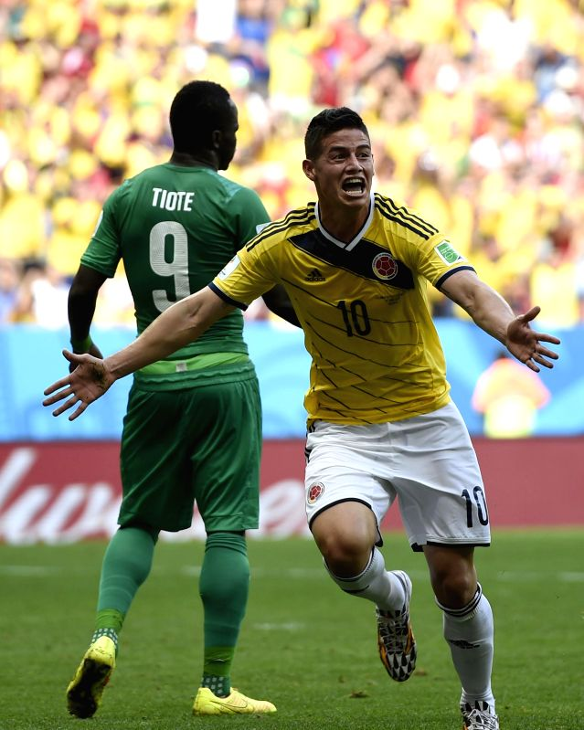 Colombia's James Rodriguez (R) celebrates for his goal during a Group C match between Colombia and Cote d'Ivoire of 2014 FIFA World Cup at the Estadio Nacional ...