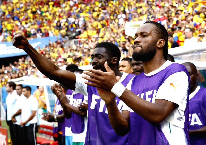Cote d'Ivoire's Didier Drogba (R) cheers for the team during a Group C match between Colombia and Cote d'Ivoire of 2014 FIFA World Cup at the Estadio Nacional ...