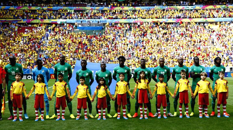 Cote d'Ivoire's players sing the national anthem during a Group C match between Colombia and Cote d'Ivoire of 2014 FIFA World Cup at the Estadio Nacional Stadium ..