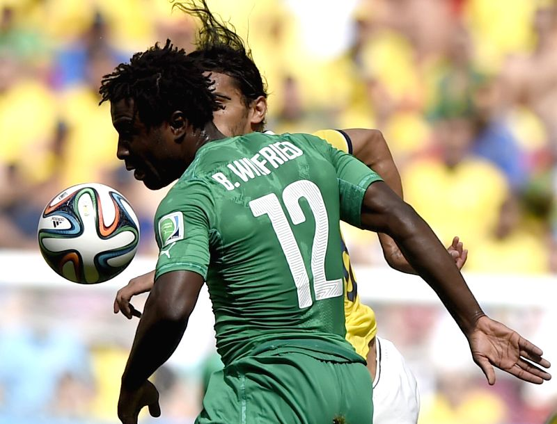 Cote d'Ivoire's Wilfried Bony (front) competes during a Group C match between Colombia and Cote d'Ivoire of 2014 FIFA World Cup at the Estadio Nacional Stadium in .
