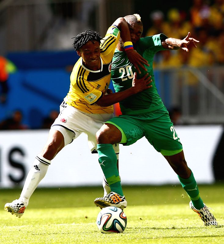 Cote d'Ivoire's Geoffroy Serey Die vies for the ball with Colombia's Juan Guillermo during a Group C match between Colombia and Cote d'Ivoire of 2014 FIFA World ...