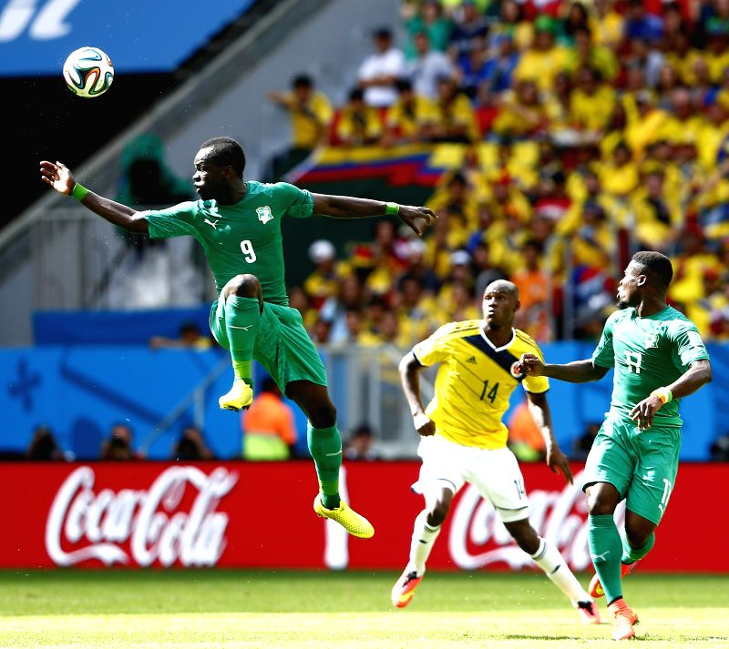 Cote d'Ivoire's Cheick Tiote (L) jumps for the ball during a Group C match between Colombia and Cote d'Ivoire of 2014 FIFA World Cup at the Estadio Nacional ...