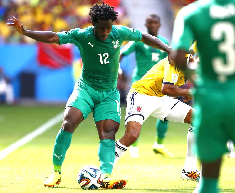 Cote d'Ivoire's Wilfried Bony vies for the ball during a Group C match between Colombia and Cote d'Ivoire of 2014 FIFA World Cup at the Estadio Nacional Stadium in