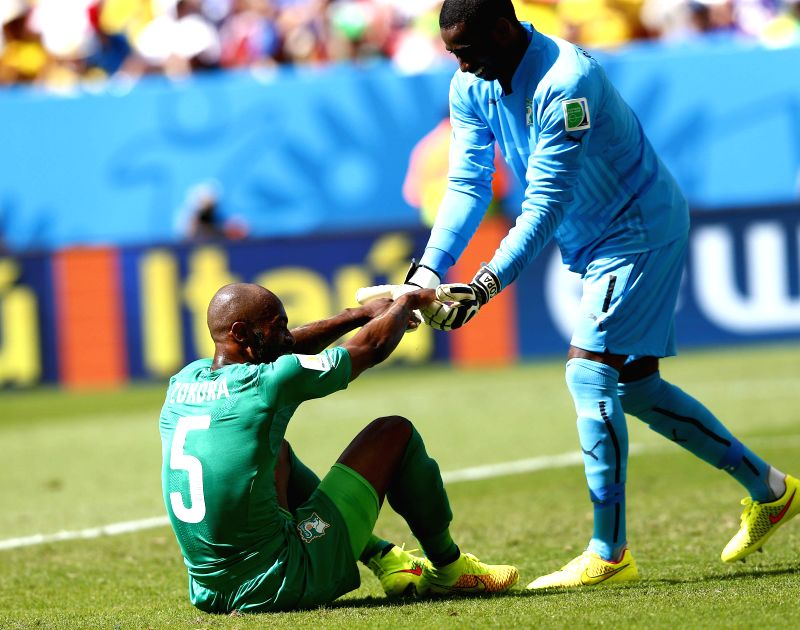 Cote d'Ivoire's goalkeeper Boubacar Barry gives a hand to Didier Zokora during a Group C match between Colombia and Cote d'Ivoire of 2014 FIFA World Cup at the ...