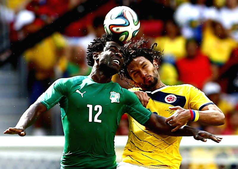 Cote d'Ivoire's Wilfried Bony (L) competes for a header with Colombia's Abel Aguilar during a Group C match between Colombia and Cote d'Ivoire of 2014 FIFA World ..