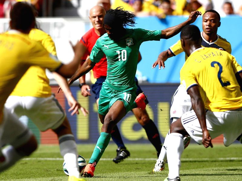 Cote d'Ivoire's Gervinho shoots a goal during a Group C match between Colombia and Cote d'Ivoire of 2014 FIFA World Cup at the Estadio Nacional Stadium in Brasilia, .