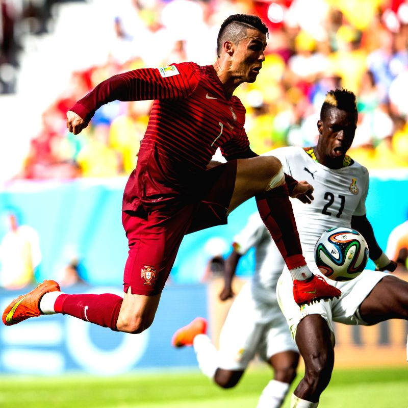 Portugal's Cristiano Ronaldo vies with Ghana's John Boye during a Group G match between Portugal and Ghana of 2014 FIFA World Cup at the Estadio Nacional Stadium ..